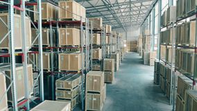 Shelves with boxes in a warehouse, close up. Big warehouse room with storage shelves
