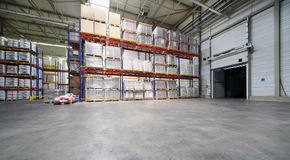 Big warehouse with shelves at Caparol factory Stock Image