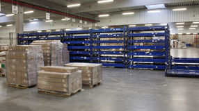 In the big warehouse. Workflows in the big warehouse Royalty Free Stock Photo