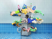 The big washing concept. The big vortex of clothes around washing machine with bottles at laundry room royalty free stock photos