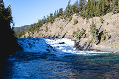 Big Waterfall. A big waterfall allows water down a rocky drop between a valley it gouged Royalty Free Stock Photos
