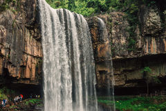 A Big WaterFall With Cave Inside Stock Photography