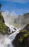 Big waterfall coming down through Stock Photos
