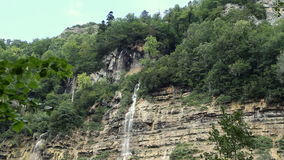 Big waterfall. In the forest stock footage