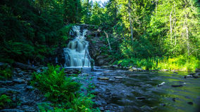 Big waterfall in the Karelia. Big waterfall in the forest stock photography