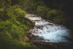 Big Waterfall. A large waterfall surrounded by vegetation Royalty Free Stock Photos