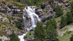 Big waterfall in Spanish Pyrenees mountains, near Valley of Nuria stock video