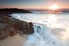 The big wave. Australian seascape at sunrise with rushing wave in foreground (currumbin,queensland,australia Stock Images