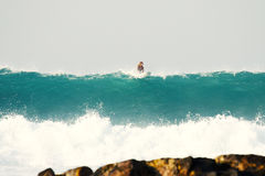 Big wave on the background of stones Royalty Free Stock Photos