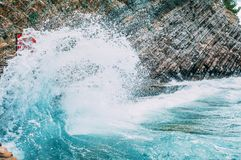Big wave beats on the rocks. Storm weather. Beautiful nature view royalty free stock images