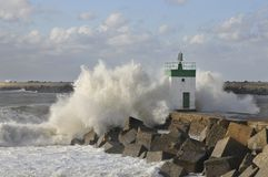 Big wave on a blocks jetty Stock Image