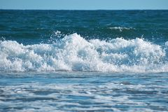 Big wave in blue ocean royalty free stock photos