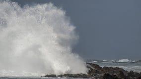 Big Wave Brakes on Rocks Royalty Free Stock Photo