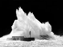 Big wave breaking on breakwater Royalty Free Stock Photo