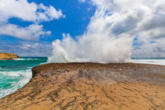 Big wave breaks on a rock with explosion like splashes Royalty Free Stock Photography