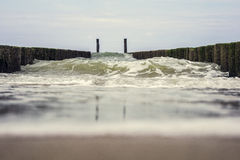 Big wave clashes on the breakwater Stock Images