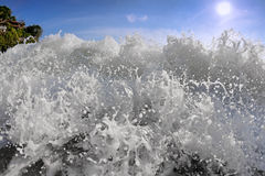 Big wave front with bubbles and splashes Stock Photos