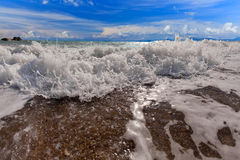 Big wave front with bubbles and splashes Royalty Free Stock Photo