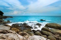 Big wave impacting the rock on coastline . Beautiful seascape of Kata beach ,Phuket with blue cloudy sky Stock Photo