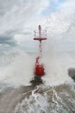 Big wave impacts on the pier Stock Images