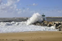Big wave on a little lighthouse Royalty Free Stock Image