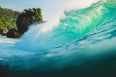 Big wave in ocean. Breaking turquoise wave in Bali. Big wave in ocean. Breaking turquoise wave Royalty Free Stock Photos
