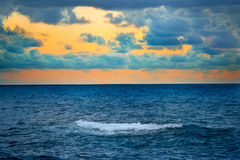 Big wave over colorful sunset Royalty Free Stock Photo