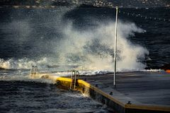 Big wave in Saint-Tropez. A big wave at the pontoon of la Ponche in Saint Tropez royalty free stock photo