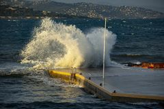 Big wave in Saint-Tropez. A big wave at the pontoon of la Ponche in Saint Tropez royalty free stock image