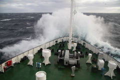 Big wave rolling over the ship Stock Photography