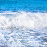 Big wave. With sea foam and blue water Stock Photography