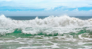 Big wave with sea foam and turquoise water. Royalty Free Stock Images