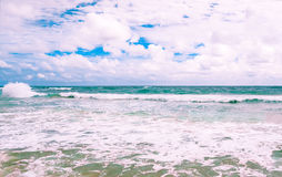 Big wave with sea foam and turquoise water. Stock Photography