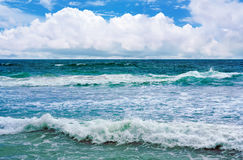 Big wave with sea foam and turquoise water. Stock Image