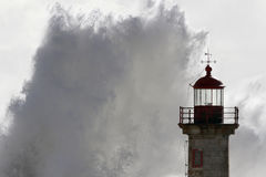 Big wave splash. Douro river mouth old lighthouse, Porto, Portugal Stock Photography