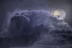 Big wave splash in a full moon night royalty free stock images