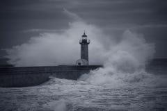 Big wave splash over old lighthouse royalty free stock images