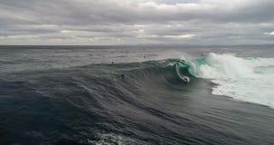 Big wave surfer stock photos