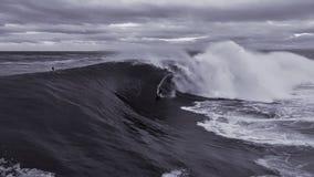 Big wave surfer stock image
