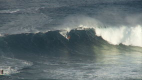 Big Wave Surfers at Jaws, Maui Hawaii - Slow Motion Clip 3 of 5 stock video footage