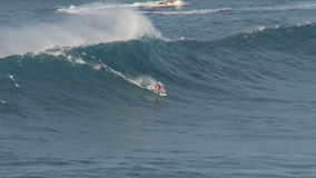 Big Wave Surfers at Jaws, Maui Hawaii - Slow Motion Clip 2 of 5 stock footage