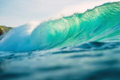 Big wave for surfing in ocean. Breaking turquoise wave in Bali. Big wave for surfing in ocean. Breaking turquoise wave Stock Images