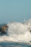 Big waves against the rocks. Santander lighthouse, Cantabria, Spain Stock Photography