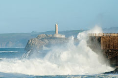 Big waves against the rocks. Santander lighthouse, Cantabria, Spain Stock Image