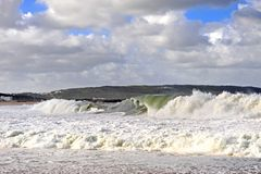 Big waves on the beach of Nazare stock image
