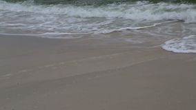 Big waves beat the shore stock footage