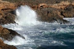 Big waves breahing on rocks of Mallorca. Big waves breaking on rocks of coast of Mallorca in time of storm Royalty Free Stock Image