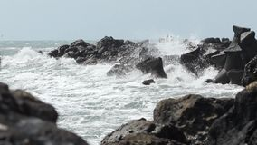 Big Waves Break on Rocks stock video footage