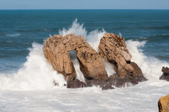 Big waves breaking against the rocks, Urros, Cantabria Stock Images