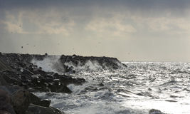 Big waves breaking on a pier Stock Photography